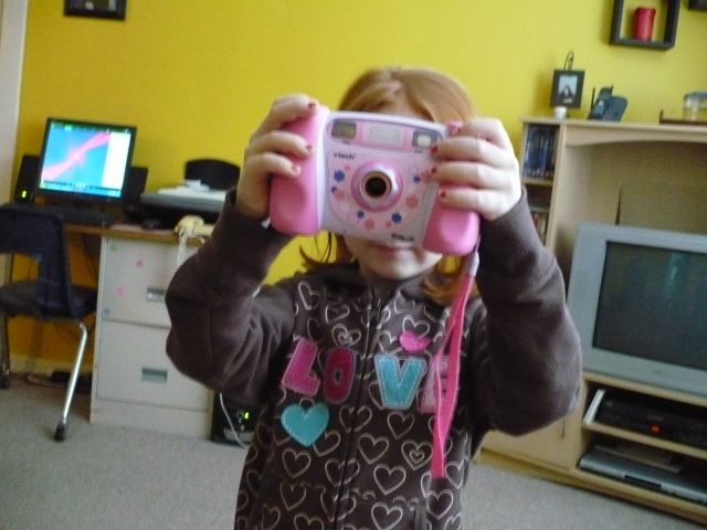 Erica loves her digital camera.